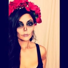 Cool Day of the Dead/Halloween makeup.
