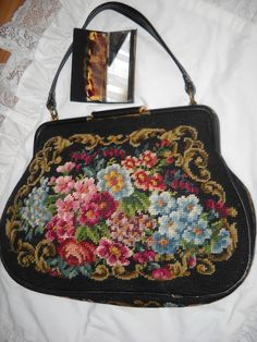 1950's Floral Tapestry/Needlepoint Handbag with mirror/comb holder. $49.00, via Etsy.