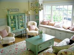 This room has well-proportioned pieces.  I like the sea foam, esp with the yellow pieces in the cabinet, altho blue is more my taste.  The floral patterns and chandelier help make this shabby chic rather feminine and sweet.