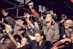 Austrians cheer Adolf Hitler during his 1938 campaign to unite Austria and Germany.