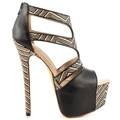 Shake up your look with the A Byss by Luichiny.  This warm weather look features a tribal printed upper with black synthetic leather.  A tall 6 1/2 inch heel and 2 inch platform complete this sleek stiletto.
