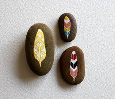 pretty painted stones... feathers
