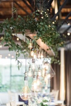 Industrial style Dallas wedding with unique lighting fixtures, plenty of lush greenery, rustic elements, and pops of color through blue table runners, place settings and blooming florals. Vintage Industrial Lighting, Rustic Lighting, Unique Lighting, Industrial Style, Industrial Farmhouse, Industrial Light Fixtures, Pendant Lighting, Deck Lighting, Kitchen Lighting