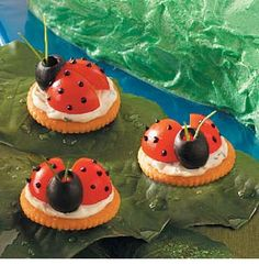 Ladybug Appetizers Prep/Total Time: 30 Min Serving Size: 12 Servings/3 dozen Ingredients 2 ounces cream cheese, softened 2 tablespoons sour cream Black paste food coloring 1/2 teaspoon minced chives 1/8 teaspoon garlic salt 1/8 teaspoon minced fresh parsley 36 butter-flavored crackers 18 cherry tomatoes, quartered 18 large pitted ripe olives 72 fresh chive pieces (about 1-1/2 inches long) Directions In a small bowl, beat cream cheese and sour cream until smooth. Re...