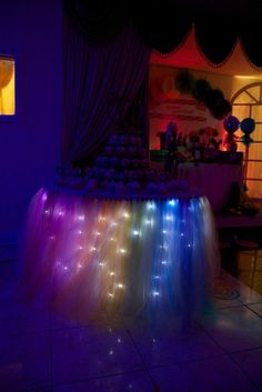 Rainbow lighted cupcake table at a party