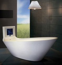 Bathroom Terrific Unique Shape White Bathtubs Designs With Exciting Built In Tv For Entertainment Space And Fantastic Crystal Chandelier Contemporary Bathtub Design - pictures, photos, images