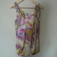 H&M floral top Pretty and feminine.  Side drape and shoulder details on the left side.  The bottom hem style keeps the bubble shape. Great condition, no sign of wear. H&M Tops Tank Tops