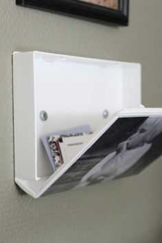 DIY-  Use old VHS Cases for a Unique, Space Saving Picture frame/Hidden storage compartment.  #diy #hiddenstorage #RVLife