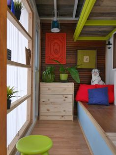 "An Ikea mini dresser, and a built-in day bed platform (with recycled Ikea roadside desk panels as lids to its hollow interior), give ""The Cub"" (a mere 40 sq ft)  more storage. 