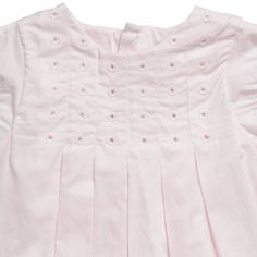 This gorgeous pale pink dress by Chloe is perfect for both special occasions and day-to-day wear. The simple A-line design has beautiful understated detailing, such as a broderie anglaise chest with pleated skirting and pretty puff sleeves. In a lightweight, double lined cotton, the dress is airy and easy-to-wear with the added benefit of a hidden zip fastening down the back.