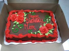 A chocolate buttercream iced quarter sheet cake with hand piped roses and accents.