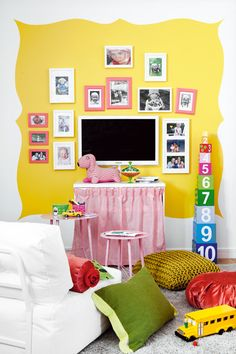 "Playroom - I like the large ""frame"" painted on the wall. Might be cute on a slightly smaller scale to frame some chalkboard painted onto the wall."