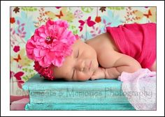 sweet baby. love that flower and the setting of the picture