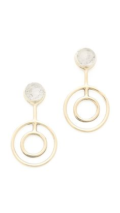 A circular brass pendant hangs from a quartz cabochon set in sterling silver on these Pamela Love earrings. Post closure.  Brass & sterling silver. Made in the USA.  Measurements Length: 1.5in / 4cm  Pamela Love Telepathy Earrings HK$ 2,012.46 Color: Brass/Clear Brass/Clear Size: One Size