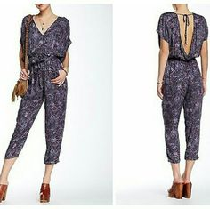 "NWT FREE PEOPLE UNIVERSAL SURPLICE JUMPSUIT A Flouncy tie snugs the waistline of a vintage inspired short sleeve jumpsuit,featuring a plunging surplice front, V-back and straight leg pants. Surplice neck with snap button closure. Back cut out with self tie closure. Elasticized waist. 2 front slash pockets. Allover print. Approximately 53"" Length. Inseam 23 1/2"" Free People Pants Jumpsuits & Rompers"