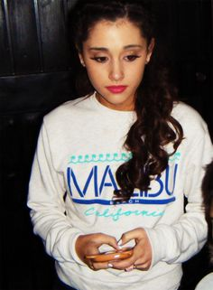 Ariana Grande thinking of what to text next.