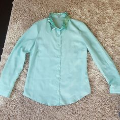 Sequins collared button down blouse! Very cute turquoise button down top! Size small only worn a few times! Just trying to make room for spring clothes! Charlotte Russe Tops Button Down Shirts