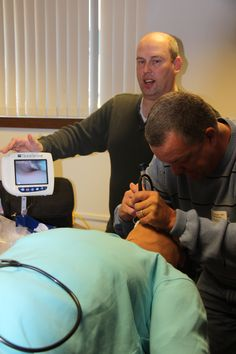 Dr. Larry Johnson using the GlideScope in Dr. Rob Butts' sim lab station in Worthington, MN on October 28, 2011