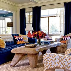 Mustard yellow and cardinal red accent pieces liven up the blues that anchor this living room. Avoid too-bright colors such as taxi yellow and fire engine red, which can make a room look like a primary-color wheel. Mustard Living Rooms, Navy Living Rooms, New Living Room, Home And Living, Living Spaces, Southern Living, Coastal Living, Blue And Yellow Living Room, Room Colors