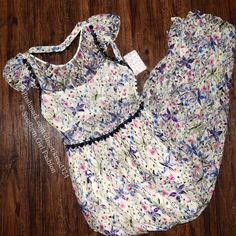 """FREE PEOPLE Floral Dress Cocktail Eyelet Maxi Prom Size 10 (medium).  New With Tags $350 Retail + Tax.   Floral printed nylon maxi dress.  Bodice is lined with a bandeau.    Measurements for Size 10 (garment flat): Length: 60"""" Underarm to Underarm: 19.5"""" Waist: 15"""" Sleeve: 5""""   ❗️ Please - no trades, PP, holds, or Modeling.    Bundle 2+ items for a 20% discount!    Stop by my closet for even more items from this brand!  ✔️ Items are priced to sell, however reasonable offers will be…"""