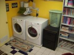 Yellow laundry room. No scary unfinished room here. Although I have big plans for this room it is a happy room right now.