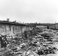 Bergen Belsen, Germany, Camp barracks and piles of corpses, after the liberation, April 1945.