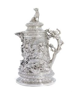 MARK OF FREDERICK ELKINGTON, BIRMINGHAM, 1880 Cylindrical with tucked-in base on circular coffered foot, profusely cast and chased with hunting vignettes, the handle cast as a branch supporting a figure of a huntsmen, the hinged domed cover applied with a finial cast as a hound,