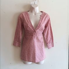 Boho Henley Pullover Blouse Front ruffle detail, floral print in a pretty pink, tie back, 3/4 length button sleeves, v neck. 100% cotton. No trades. Generous discount with bundle. Canyon River Blues Tops Blouses
