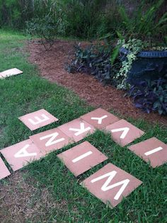 "Yard Scrabble! These are 12x12 squares with painted on letters. There are 144 ""tiles."" Here's how many of each letter you need. 2: J, K, Q, X, Z 3: B, C, F, H, M, P, V, W, Y 4: G 5: L 6: D, S, U 8: N 9: T, R 11: O 12: I 13: A 18: E note the ivy by the ivy"
