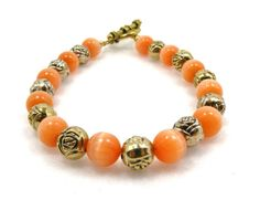 Handmade bracelet with orange mother of by ZoilaBelleCreations, $40.00