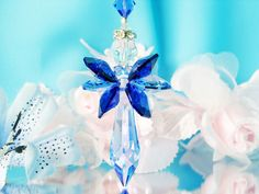 Guardian Angel Car Charm created with Swarovski Sapphire Blue and Aurora Borealis Crystals.
