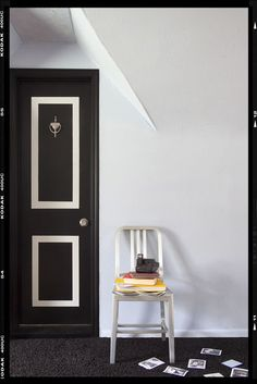 Faux paneled door. DIY a clever makeover, using paint to create a paneled look and adding a door knocker for a touch of whimsy.