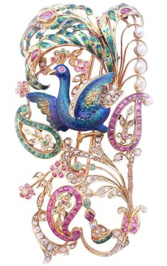 A tall and exquisitely crafted Art Nouveau Brooch, representing a fantasy bird immersed in floral decorations, embellished by fine enamelling, pearls, rubies, emeralds, and diamonds on an 18kt yellow gold mounting. France, circa 1900.