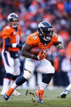 Montee Ball #28 of the Denver Broncos carries the ball against the San Diego Chargers during the AFC Divisional Playoff Game at Sports Authority Field at Mile High on January 12, 2014 in Denver, Colorado.