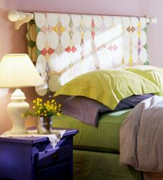 I love this idea of using the quilt for a headboard! (from BH)