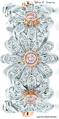 Tiffany & Co. Daisy ring with white and Fancy Vivid Pink diamonds.