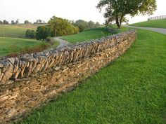 the stone fences @ Shaker Village of Pleasant Hill, Kentucky. You see them around the big horse farms near Lexington too. Country Fences, Pleasant Hill, Stone Fence, My Old Kentucky Home, Horse Farms, Back Home, Travel Photos, Countryside, Places To Go