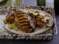 Guy Fieri's Caribbean Chicken - This tangy marinade gets big heat with a chopped jalapeno, seeds and all, and bring a taste of the islands with lime zest, fresh orange juice and some thyme. http://www.foodnetwork.com/recipes/caribbean-chicken-recipe-1910109