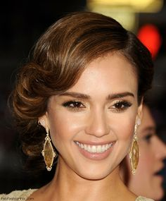 Gorgeous Jessica Alba with golden eyes makeup and retro updo hairstyle at 2014 MET Gala.
