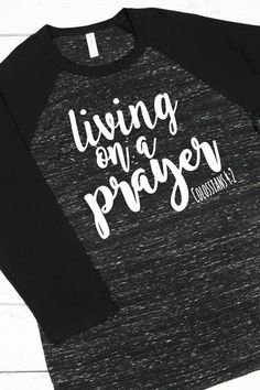 """This raglan tee will be your go-to tee this season! Pair with jeans or leggings for the perfect look! """"Devote yourselves to prayer with an alert mind and a thankful heart."""" Colossians 4:2 #livingonaprayer #graphictee #ewamboutique"""