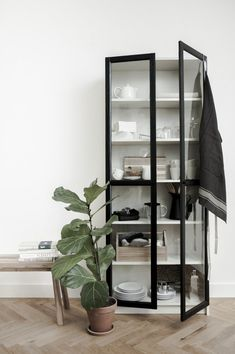 IKEA Billy Bookcase hack - We're all about the less-is-more approach with this one, which entails a seemingly plain white bookcase paired with an ingeniously simple add-on: a pair of glass doors. The result? A style-focused take on a modern cabinet that's Ikea Bookshelves, Decor Buy, Bookshelves Diy, Bookcase, Billy Bookcase Hack, Ikea Billy, French Doors Interior, Home Decor, Ikea Billy Bookcase Hack