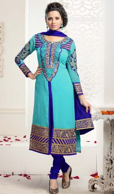Revamp your wardrobe with something new as you don this turquoise color georgette embroidered churidar kameez. You'll see some interesting patterns carried out with patch, lace and resham work. #turquisecolorsuit #embroideredsalwarkameez #straightcutdress