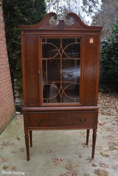 """This vintage china cabinet makeover was only $40 at the thrift store! After a coat of RECLAIM Beyond Paint, it looks amazing now! This is the """"BEFORE""""! You've got to see the """"AFTER."""" #ad #RECLAIMyourFurniture"""