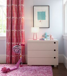 Girl's bedroom with floor length drapes, modern dresser and shag rug