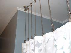 Bathroom with gray walls, custom curtain hardware and custom shower curtain