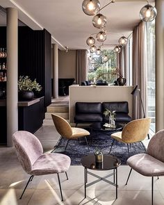 Earthy palettes with dark contrasts defines the newly refurbished Mauritzhof hotel in Münster. The Beetle Lounge Chair and TS Tables offer the perfect atmosphere in the hotel's lounge area. Interior concept by Lambs and Lions #gubi #gubiofficial #gubistore #beetleloungechair #tstable #gamfratesi