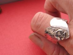 heart with peace sign ring