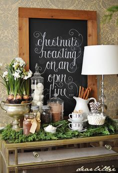 Love the idea of a hot chocolate bar, but I really love the lettering on the chalk board.  {Tipsy Christmas Cheer} just add booze for a  christmas hot Chocolate Bar --had one at last year's party and it was a hit!