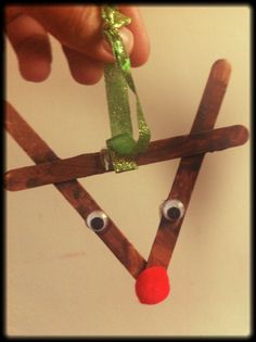 A Popsicle stick reindeer made by Dante, 3 years old • Art My Kid Made Artist of the day on Dec. 21, 2012. #kidart