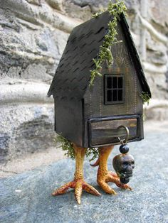 Baba Yaga's House. The house is paper, the chicken feet are polymer clay and the matchbox its on is 1 inch by 1 1/2 inches.  By L. Mahaffey  cackleandhoot.blogspot.com